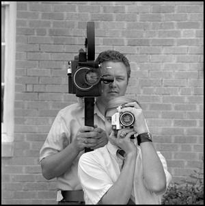 Primary view of object titled '[Roy and Harvey Bray with cameras]'.