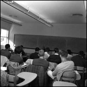 Primary view of [Students at desks in classroom]