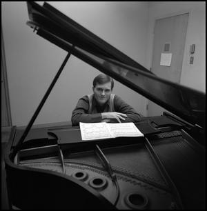 Primary view of object titled '[Bill Blaine sitting and resting arms on piano 2]'.