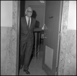 Primary view of object titled '[Dean Witt Blair standing in doorway]'.