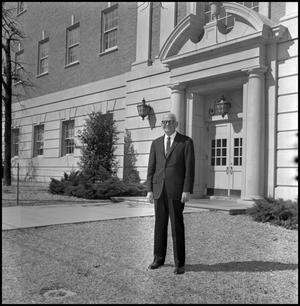 Primary view of object titled '[Dean A. Witt Blair outside of Education Home Economics Building]'.