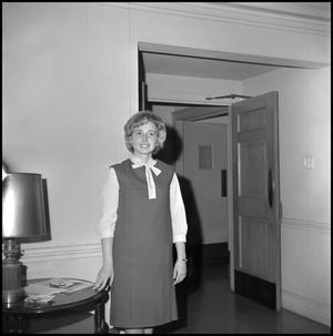 Primary view of object titled '[Roybeth Blackburn standing by doorway]'.