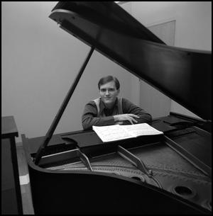 Primary view of object titled '[Bill Blaine sitting and resting arms on piano 1]'.