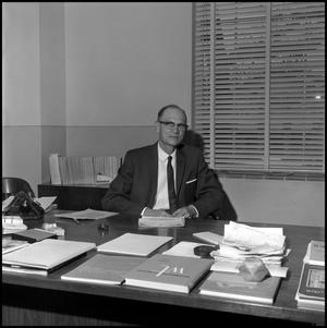 Primary view of object titled '[Dr. Earle Blanton seated at desk, from above 2]'.