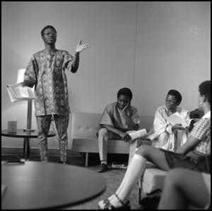 Primary view of object titled '[Olayiwola Abegunrin participating on a panel during Black Awareness Week]'.