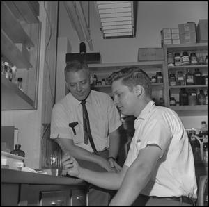 Primary view of object titled '[Graduate Students in Biology lab 8]'.
