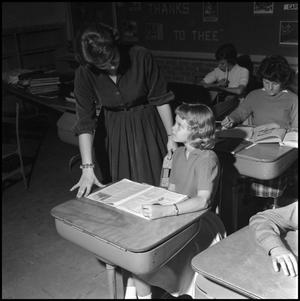 Primary view of object titled '[Sharon Branscomb helping a lab school student with reading]'.