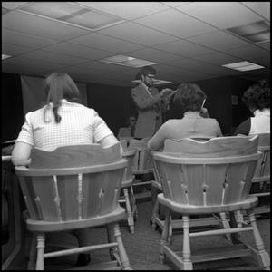 Primary view of object titled '[Professor reads from book during Black Awareness Week]'.