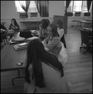 Primary view of object titled '[Teresa Bond speaking with other students, from side]'.