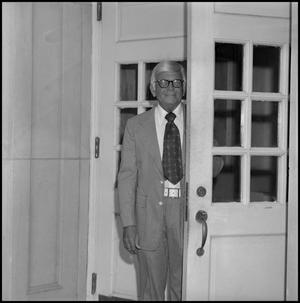 Primary view of object titled '[Dean A. Witt Blair standing behind door]'.