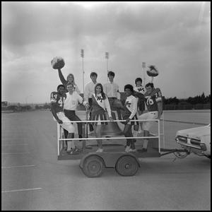 Primary view of object titled '[Students with Spirit Bell on trailer 4]'.