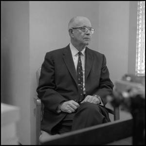 Primary view of object titled '[Robert Caldwell sitting in office 1]'.
