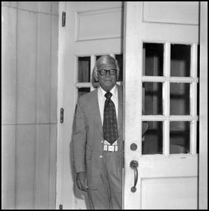 Primary view of object titled '[Dean A. Witt Blair standing in doorway]'.