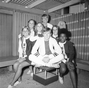 Primary view of object titled '[Cheerleaders sitting in a wooden shed]'.
