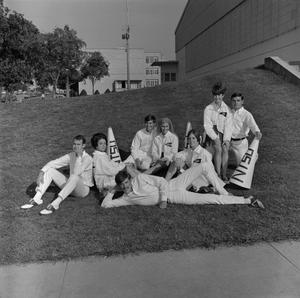 Primary view of object titled '[Cheerleaders sitting on grass]'.
