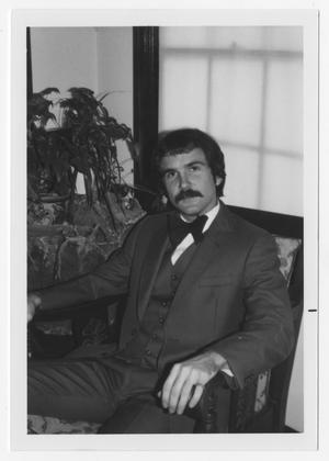 Primary view of object titled '[Bill Nelson sitting in chair]'.