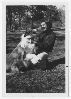 Primary view of object titled '[Bill Nelson smiling with rough collie]'.