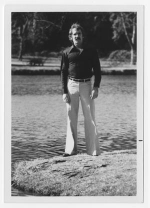 Primary view of object titled '[Bill Nelson standing next to water]'.