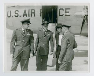 Primary view of object titled '[Captain J.A. Price and President Matthews in front of U.S. Air Force plane 1956]'.