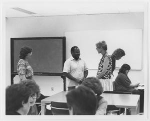 Primary view of object titled '[Herman Totten speaking to SLIS students]'.