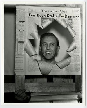 Primary view of object titled '[Charles Dameron holding drafted article]'.
