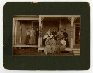 Primary view of [Group of women on the porch of a boarding house, ca. 1900]