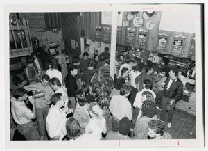 Primary view of object titled '[Students waiting in line to order food at the Flying Tomato]'.