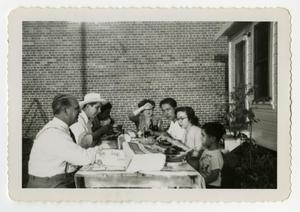 Primary view of object titled '[Family eating outside]'.