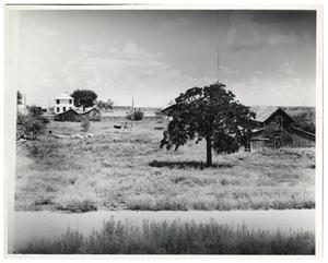 Primary view of object titled '[Farmhouse and barns]'.