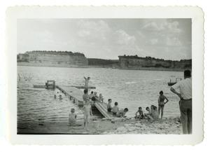 Primary view of object titled '[Children sitting on port]'.
