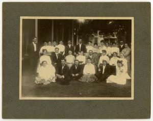 Primary view of [Men and women on the lawn of a boarding house]