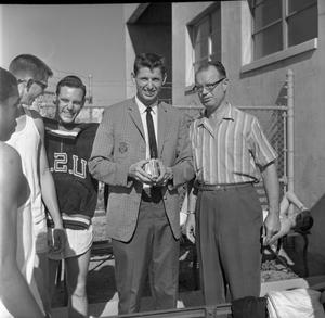 Primary view of object titled '[David Clark receiving Olympic sweater]'.