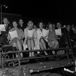 Primary view of object titled '[Audience singing during Christmas celebration]'.