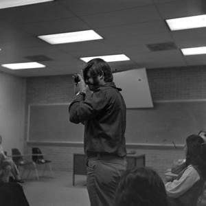 Primary view of object titled '[Student taking a picture with his camera]'.
