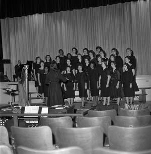 Primary view of object titled '[Choralettes rehearsing on stage]'.