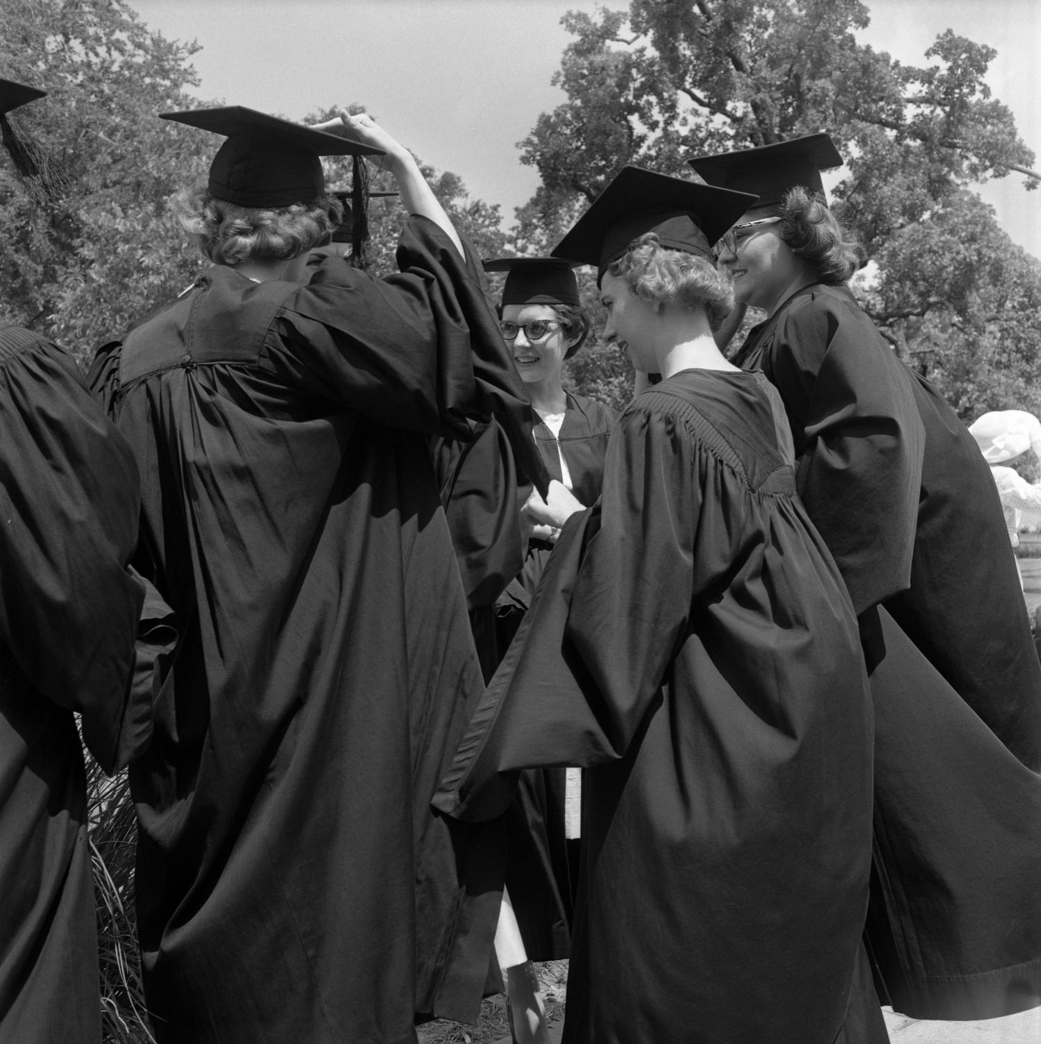 Graduates lined up outside for commencement] - Digital Library