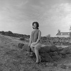 Primary view of object titled '[Mary Lee Clinkinghead sitting on rocks]'.