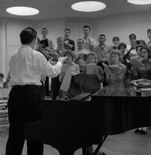 Primary view of object titled '[Richard Lamb directing the chapel choir during rehearsal]'.