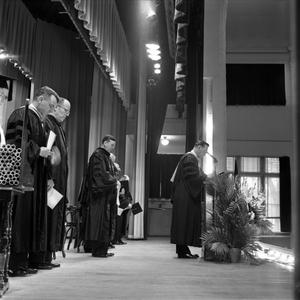 Primary view of object titled '[Faculty speaking at commencement ceremony]'.