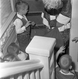 Primary view of object titled '[Santa Claus visiting kids at a Christmas party]'.