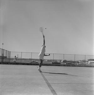 Primary view of object titled '[Charlie Chrane playing tennis]'.
