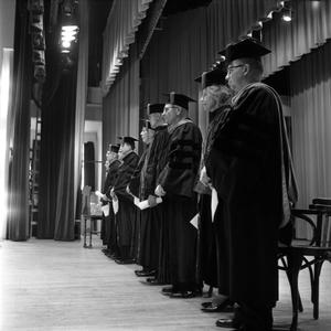 Primary view of object titled '[Faculty standing on stage during commencement 1961]'.
