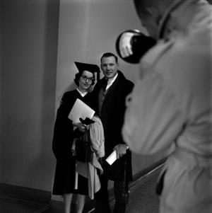 Primary view of object titled '[Graduate having her photo taken]'.