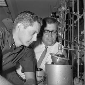 Primary view of object titled '[Two male chemistry students conducting research]'.