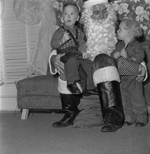Primary view of object titled '[Santa Claus with two kids at a Christmas party]'.