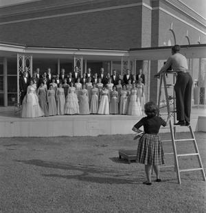 Primary view of object titled '[A Cappella Choir posing for a photograph on an outside stage]'.