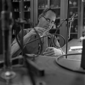 Primary view of object titled '[Male student conducting research in the Chemistry lab]'.