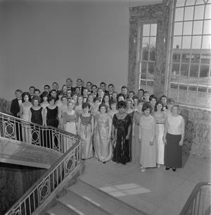Primary view of object titled '[A Cappella choir group photo on staircase landing]'.