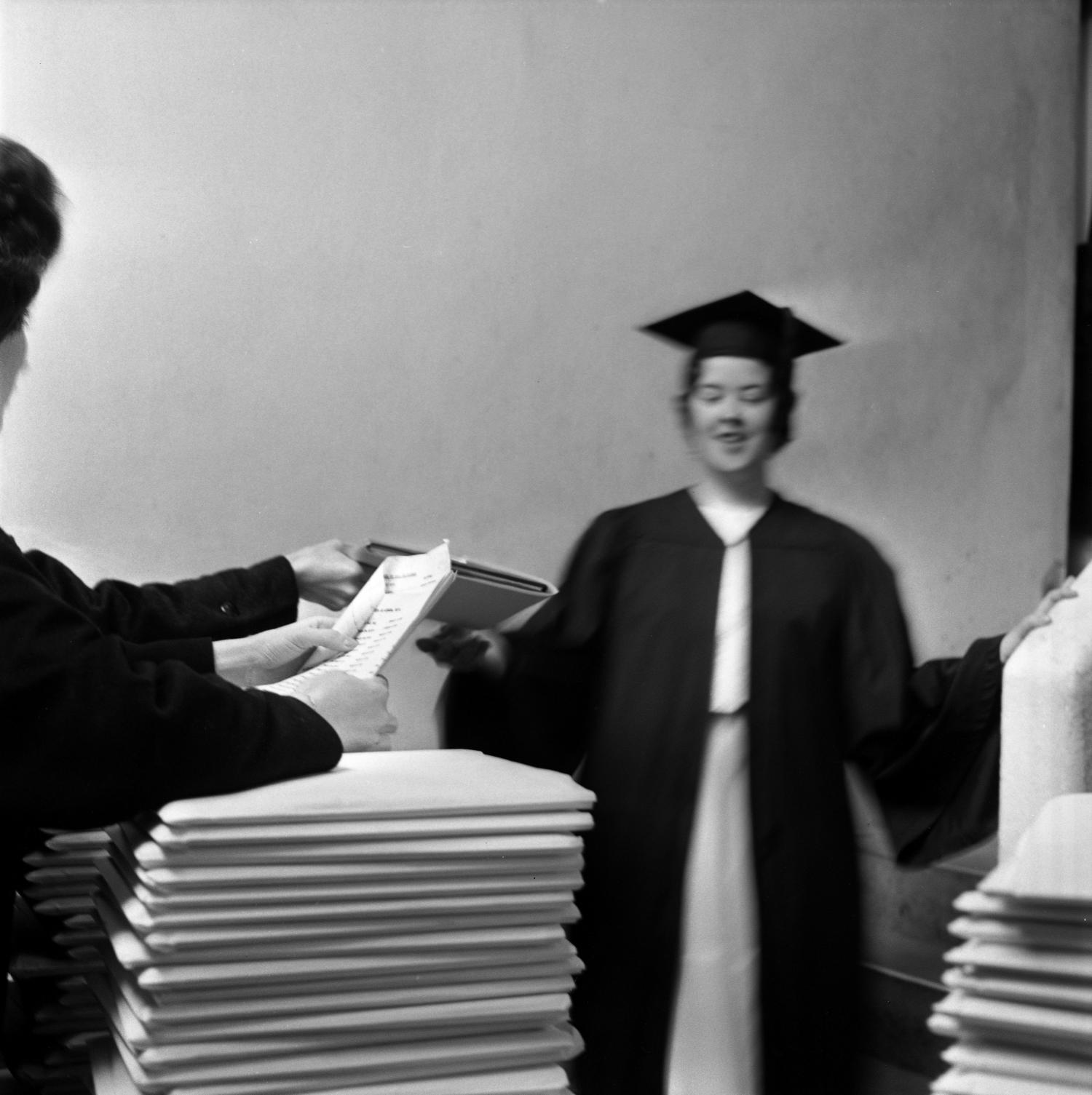 Graduate receiving commencement ceremony information] - Digital Library