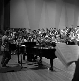 Primary view of object titled '[Dallas Symphony Director with Grand Chorus]'.